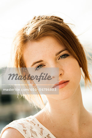 Close-up portrait of teenage girl outdoors, looking at camera Stock Photo - Premium Royalty-Free, Image code: 600-06786803