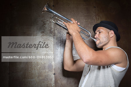 Portrait of Musician Playing Trumpet, Studio Shot Stock Photo - Premium Royalty-Free, Image code: 600-06803953