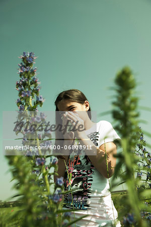 Girl having Allergic Reaction to Plants, Mannheim, Baden-Wurttemberg, Germany Stock Photo - Premium Royalty-Free, Image code: 600-06808911