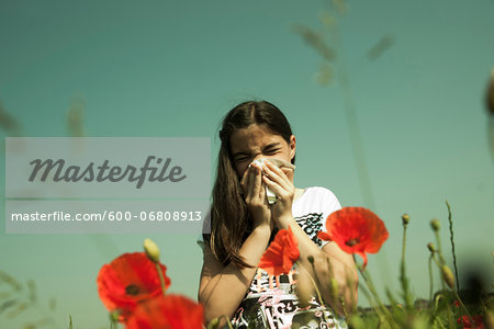 Girl having Allergic Reaction to Plants, Mannheim, Baden-Wurttemberg, Germany Stock Photo - Premium Royalty-Free, Image code: 600-06808913