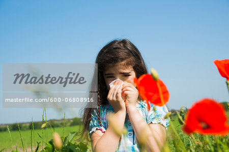 Girl Blowing Nose in Flower Field, Mannheim, Baden-Wurttemberg, Germany Stock Photo - Premium Royalty-Free, Image code: 600-06808916