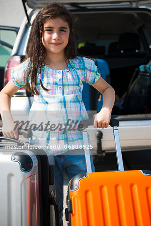 Girl Loading Luggage in Van for Vacation, Mannheim, Baden-Wurttemberg, Germany Stock Photo - Premium Royalty-Free, Image code: 600-06808925