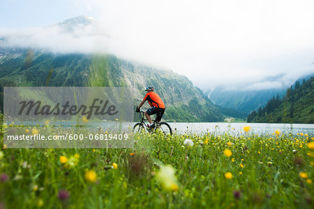 Mature Man Riding Mountain Bike by Vilsalpsee, Tannheim Valley, Tyrol, Austria Stock Photo - Premium Royalty-Free, Image code: 600-06819409
