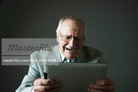 Senior Man using Tablet Computer, Studio Shot Stock Photo - Premium Royalty-Free, Image code: 600-06819429