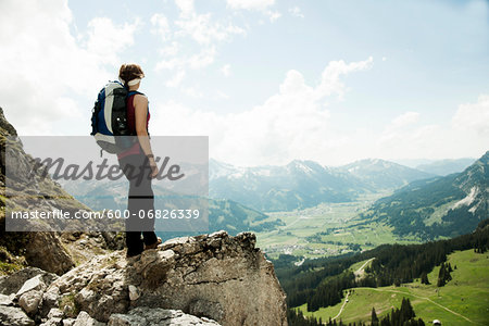 Mature woman standing on cliff, hiking in mountains, Tannheim Valley, Austria Stock Photo - Premium Royalty-Free, Image code: 600-06826339