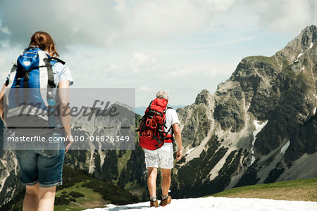 Backview of mature couple hiking in mountains, Tannheim Valley, Austria Stock Photo - Premium Royalty-Free, Image code: 600-06826349