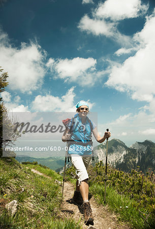 Mature woman hiking in mountains, Tannheim Valley, Austria Stock Photo - Premium Royalty-Free, Image code: 600-06826359
