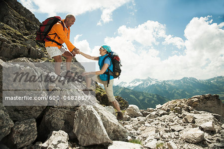 Mature couple hiking in mountains, Tannheim Valley, Austria Stock Photo - Premium Royalty-Free, Image code: 600-06826377