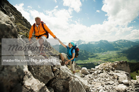Mature couple hiking in mountains, Tannheim Valley, Austria Stock Photo - Premium Royalty-Free, Image code: 600-06826379