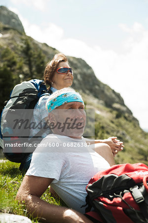Close-up of mature couple sitting on grass, hiking in mountains, Tannheim Valley, Austria Stock Photo - Premium Royalty-Free, Image code: 600-06826387
