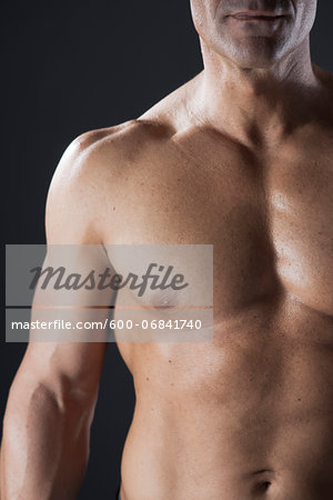Close-up of Muscular Man's Chest, Studio Shot Stock Photo - Premium Royalty-Free, Image code: 600-06841740