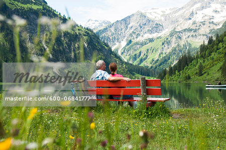 Couple Sitting on Bench by Lake, Vilsalpsee, Tannheim Valley, Tyrol, Austria Stock Photo - Premium Royalty-Free, Image code: 600-06841777
