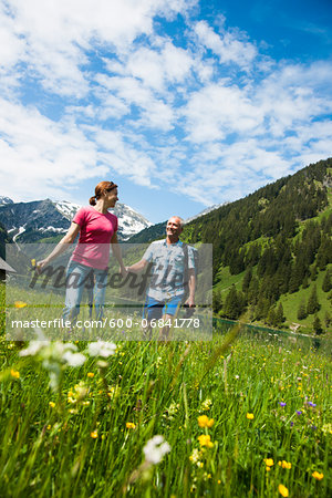 Couple Hiking, Vilsalpsee, Tannheim Valley, Tyrol, Austria Stock Photo - Premium Royalty-Free, Image code: 600-06841778