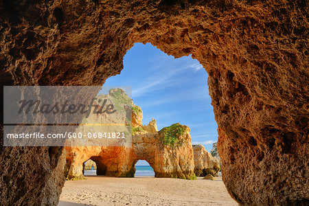 Natural Arch Rock Formations at Praia dos Tres Irmaos, Alvor, Portimao, Algarve, Portugal Stock Photo - Premium Royalty-Free, Image code: 600-06841821