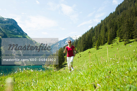 Mature woman power walking, Lake Vilsalpsee, Tannheim Valley, Austria Stock Photo - Premium Royalty-Free, Image code: 600-06841902