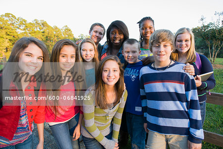 Group portrait of pre-teens standing outdoors, smiling and looking at camera, Florida, USA Stock Photo - Premium Royalty-Free, Image code: 600-06841925