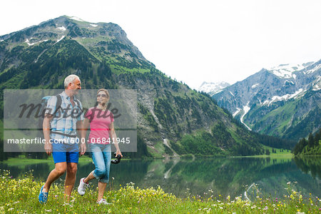 Mature couple hiking in mountains, Lake Vilsalpsee, Tannheim Valley, Austria Stock Photo - Premium Royalty-Free, Image code: 600-06841945