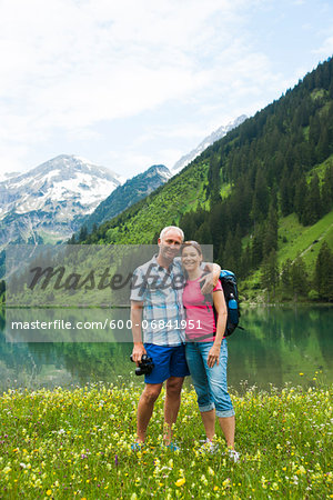 Portrait of mature couple hiking in mountains, Lake Vilsalpsee, Tannheim Valley, Austria