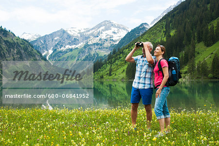 Mature couple hiking in mountains, Lake Vilsalpsee, Tannheim Valley, Austria Stock Photo - Premium Royalty-Free, Image code: 600-06841952