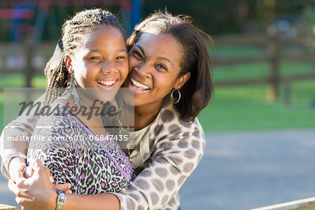 Portrait of pre-teen girl and mother, hugging outdoors Stock Photo - Premium Royalty-Free, Image code: 600-06847435