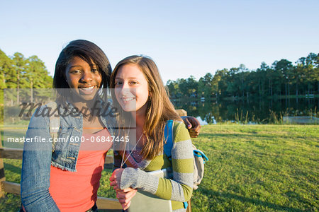 Portrait of pre-teen girls smiling and looking at camera, outdoors Stock Photo - Premium Royalty-Free, Image code: 600-06847445