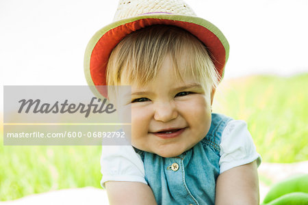 Portrait of Baby Girl Outdoors, Mannheim, Baden-Wurttemberg, Germany Stock Photo - Premium Royalty-Free, Image code: 600-06892792
