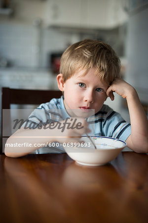 Young Boy eating Breakfast at Kitchen Table, Copenhagen, Denmark Stock Photo - Premium Royalty-Free, Image code: 600-06899693
