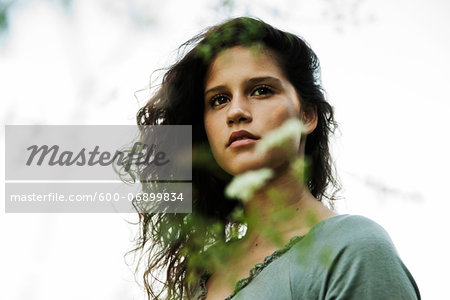 Portrait of teenaged girl outdoors in nature, looking into the distance, Germany Stock Photo - Premium Royalty-Free, Image code: 600-06899834