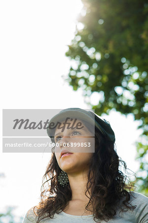 Close-up portrait of teenaged girl wearing cap outdoors, looking into the distance, Germany Stock Photo - Premium Royalty-Free, Image code: 600-06899853