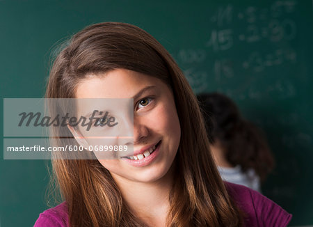 Close-up portrait of girl in classroom, Germany Stock Photo - Premium Royalty-Free, Image code: 600-06899889