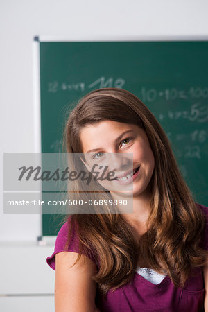 Portrait of girl in classroom, Germany Stock Photo - Premium Royalty-Free, Image code: 600-06899890