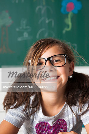 Close-up portrait of girl sitting at desk in classroom, Germany Stock Photo - Premium Royalty-Free, Image code: 600-06899898