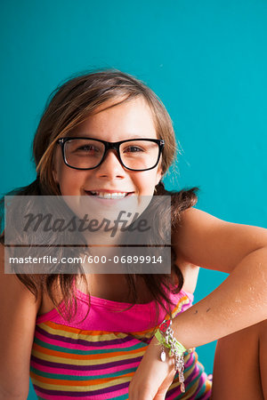 Portrait of girl wearing eyeglasses, smiling at camera, Germany Stock Photo - Premium Royalty-Free, Image code: 600-06899914