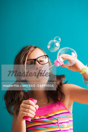 Girl blowing bubbles, Germany Stock Photo - Premium Royalty-Free, Image code: 600-06899916