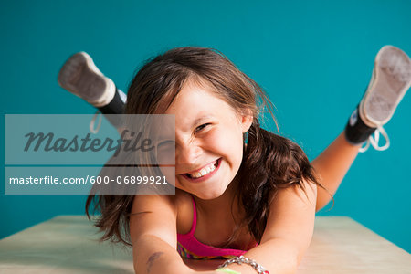 Portrait of girl looking at camera, making funny faces, Germany Stock Photo - Premium Royalty-Free, Image code: 600-06899921