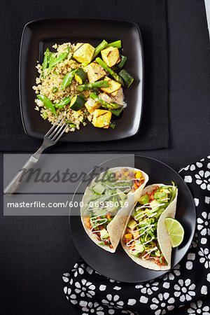 Overhead View of Quinoa with Zucchini, Asparagus and Tofu and Tacos with Bean Mix and Avocado, Studio Shot Stock Photo - Premium Royalty-Free, Image code: 600-06935019