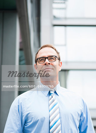 Portrait of Businessman Outdoors, Mannheim, Baden-Wurttemberg, Germany Stock Photo - Premium Royalty-Free, Image code: 600-06939765