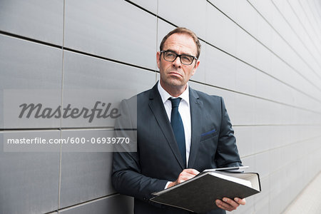 Portrait of Businessman using Tablet Computer Outdoors, Mannheim, Baden-Wurttemberg, Germany Stock Photo - Premium Royalty-Free, Image code: 600-06939770