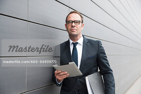 Portrait of Businessman using Tablet Computer Outdoors, Mannheim, Baden-Wurttemberg, Germany Stock Photo - Premium Royalty-Free, Image code: 600-06939771