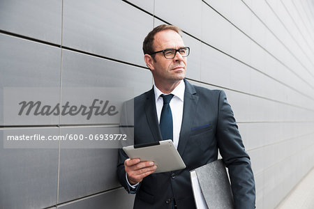 Portrait of Businessman using Tablet Computer Outdoors, Mannheim, Baden-Wurttemberg, Germany Stock Photo - Premium Royalty-Free, Image code: 600-06939772