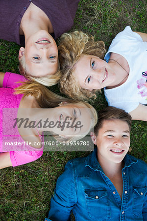 Overhead View of Teenagers Lying on Grass, Mannheim, Baden-Wurttemberg, Germany Stock Photo - Premium Royalty-Free, Image code: 600-06939780