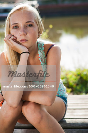 Portrait of teenage girl outdoors, looking at camera, Germany Stock Photo - Premium Royalty-Free, Image code: 600-06961040