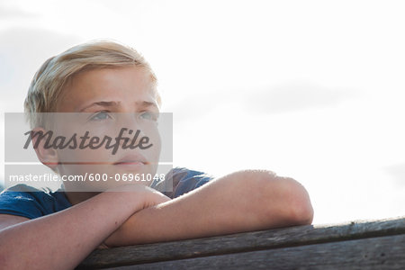 Close-up portrait of boy outdoors, looking into the distance, Germany Stock Photo - Premium Royalty-Free, Image code: 600-06961048