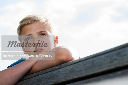 Close-up portrait of boy outdoors, looking into the distance, Germany Stock Photo - Premium Royalty-Free, Image code: 600-06961049