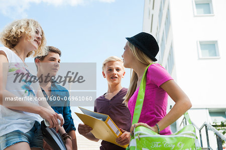 Group of teenagers standing outdoors talking, Germany Stock Photo - Premium Royalty-Free, Image code: 600-06961060