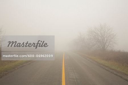 Two Lane Highway in Fog, Town of Mount Albert, Ontario, Canada Stock Photo - Premium Royalty-Free, Image code: 600-06962009