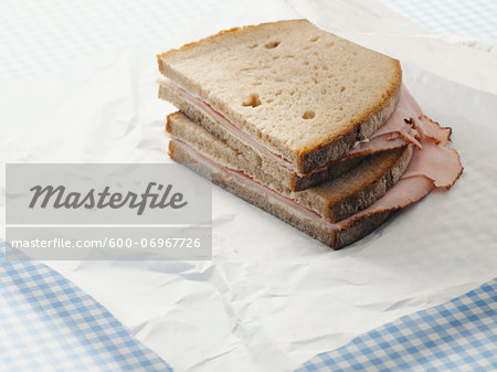 Close-up of Ham Sandwich on Parchment Paper Stock Photo - Premium Royalty-Free, Image code: 600-06967726