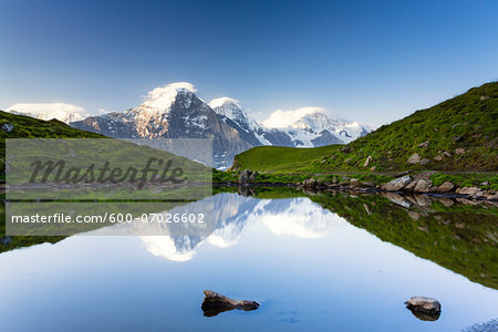 Eiger, Monch and Jugnfrau Mountains reflecting in Alpine Lake, Bernese Alps, Canton of Bern, Switzerland Stock Photo - Premium Royalty-Free, Image code: 600-07026602