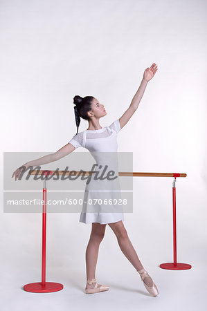 Young woman as ballet dancer, studio shot on white background Stock Photo - Premium Royalty-Free, Image code: 600-07066928
