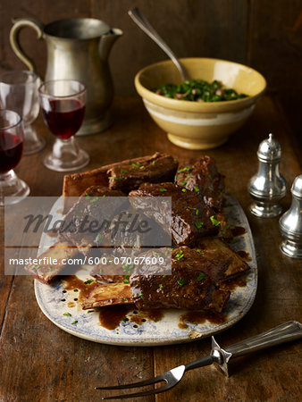 Beef Ribs on Platter with Side Dish and Glasses of Red Wine, Studio Shot Stock Photo - Premium Royalty-Free, Image code: 600-07067609